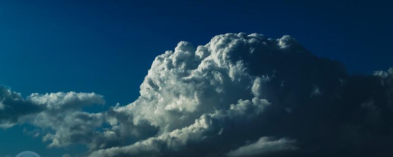 Magnificent white Cumulonimbus cloud in blue sky. Australia.