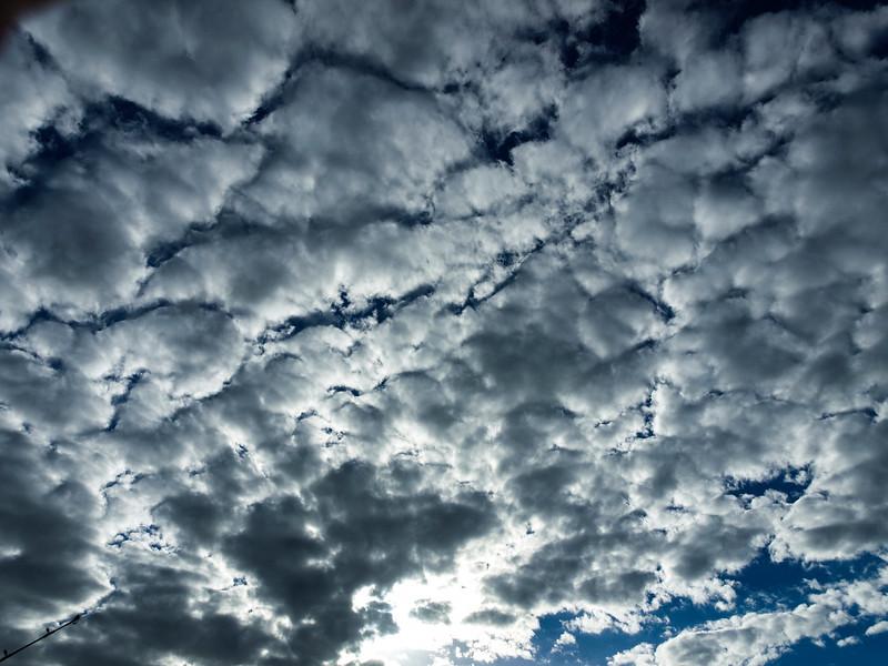 Typical Altocumulus cloud formationin blue sky.