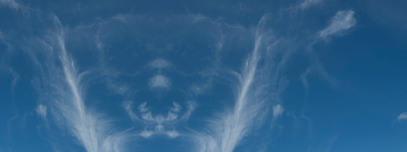 Nephology art. A beautiful sky cloudscape scene, with white (TYPE) cloud in a mid blue sky.