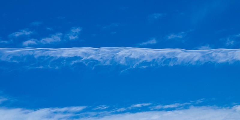 Magnificent white Contrail Cirrus cloud in blue sky. Australia.