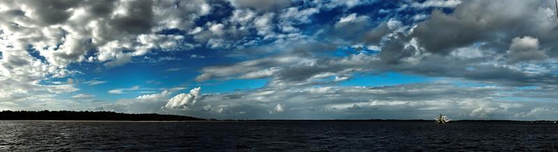 Magnificent white nimbostratus cloud panorama in blue sky. Australia.