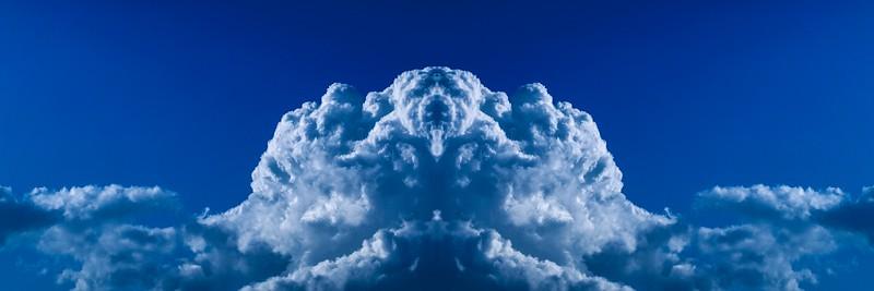 Magnificent white unusual cloud in blue sky. Australia.