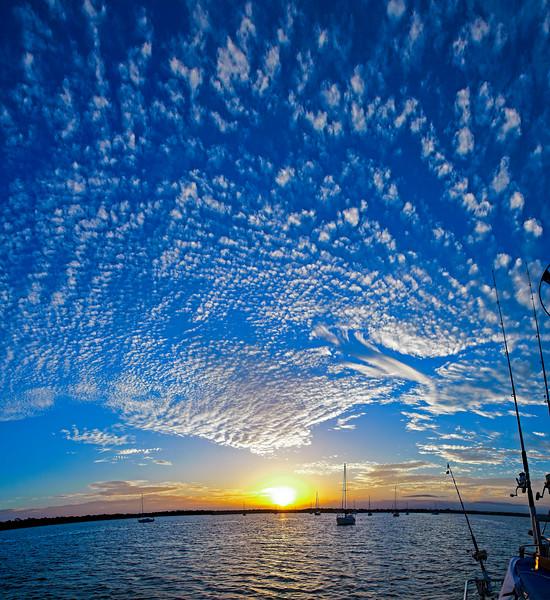 Pretty white Altocumulus cloud in blue sky. Australia.