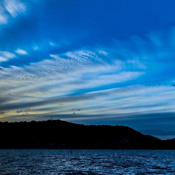 Magnificent white Cirrostratus cloud in blue sky. Australia.