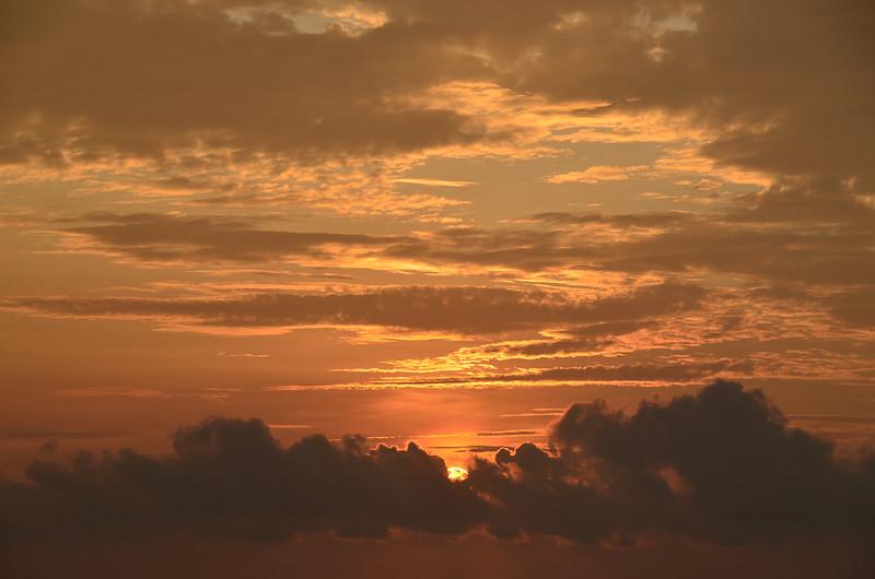 A vibrant orange coloured stratocumulus cloudy sunrise. A nature sky image