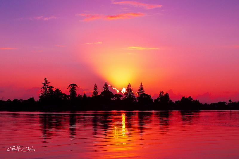 Magenta Sunrise over Water.