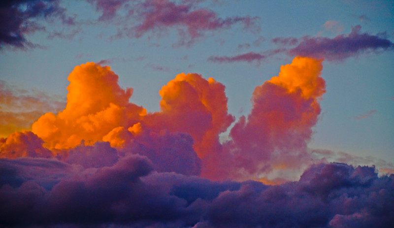 Magnificent Orange Cumulonimbus cloud in blue sky. Australia.
