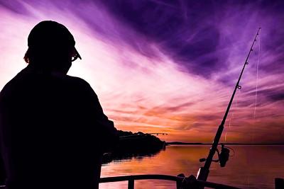 Purple and orange colored cirrus cloud, sunset seascape.