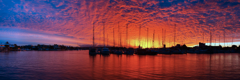 Crimson and Blue Sunset Panorama.  Art photo .