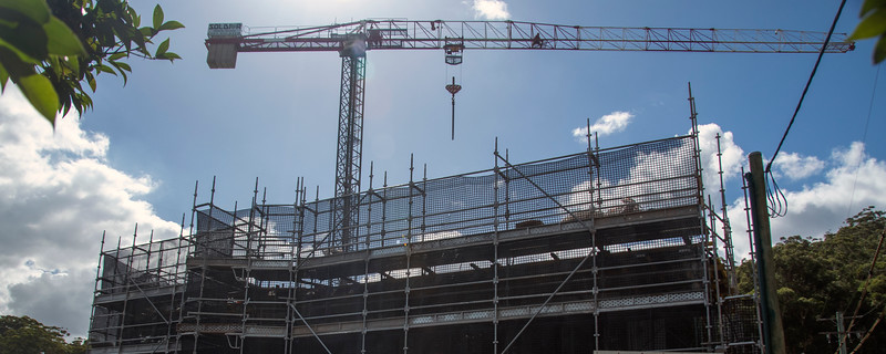 Construction progress on, top floor, on new building site with building crane close up.. Gosford, Australia. March 7, 2021. 56-58 Beane St. Part of a series.