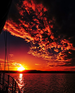 Red colored altocumulus cloud, sunset seascape.