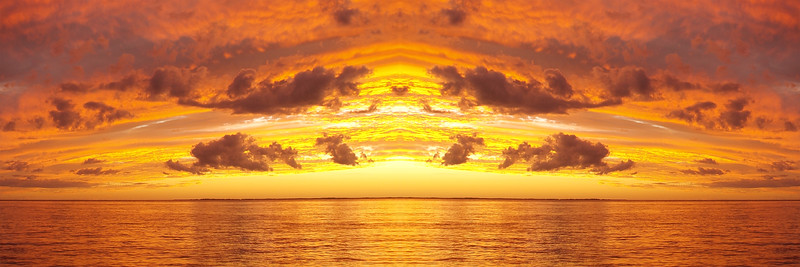 Orange and gold coloured Cirrus and Cumulus cloudy coastal Sunset Seascape. Australia