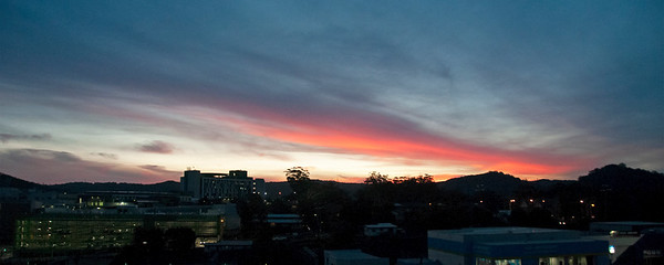 Red colored cirrostratus cloud, sunset landscape panorama.