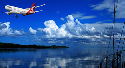 Aircraft in flight with cumulonimbus cloud in blue sky. Australia.