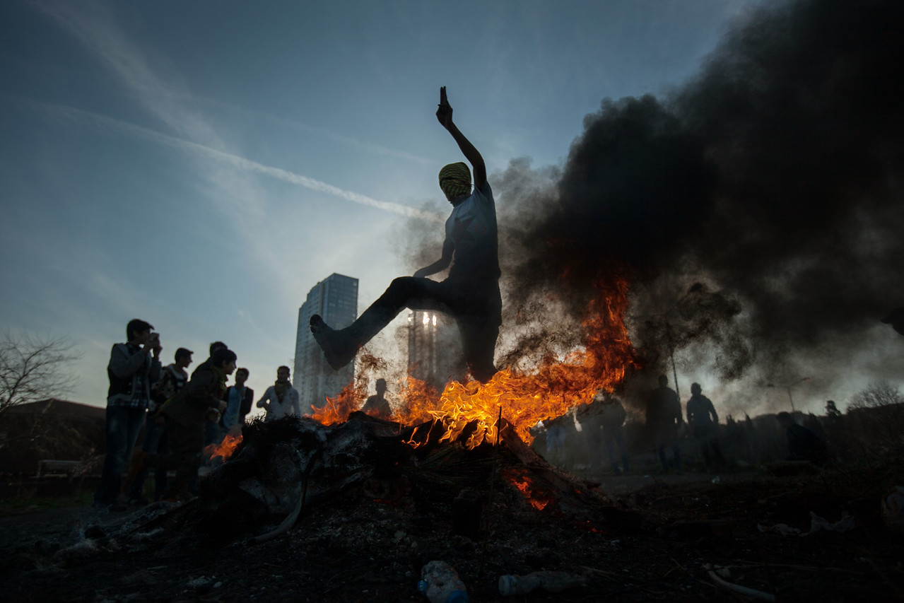 A kurdish boy jumps over the fire during the Newroz festival to mark the first day of spring in Zeytinburnu, Istanbul, Turkey, Sunday 22 March, 2015 During Newroz people display red, green and yellow flags of the Kurdish rebel group PKK. The Kurds use the Newroz festival to promote the Kurdish culture. (Andrés Gutiérrez/TheStand)