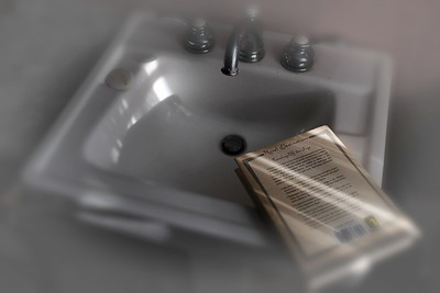 Bathroom sink and book