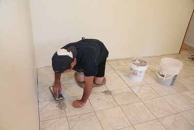 July 5: Day 13 --Chris applying grout to kitchen floor