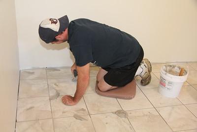 Chris applying grout