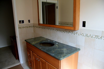 Granite placed on vanity -- Verde Vecchio is the name of the granite.