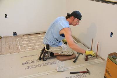 Craig tacking the cement board