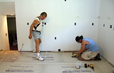 Positioning the cement board -- they are very precise!
