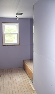 The sheetrock in the bathroom is a beautiful lavender color -- it is a special sheetrock that is moisture resistant.