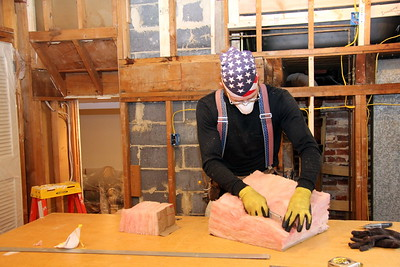 Craig cutting insulation to size