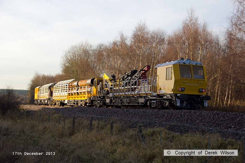 131217-020    The rest of the HOPS piling consist is seen at Ollerton pit tip wood on the High Marnham Test Track, nearest is MPV no 99 70 9131 005-9, followed by pile carrying wagon no 006-2, and finally MPV no 003-4. This pile carrying wagon has also been numbered wrong, one of the MPV's in the concrete batching consist is 006-7, this wagon should be 002-6.