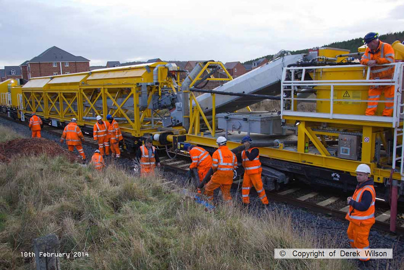 140210-044     The Hops electrification train at Ollerton, on the High Marnham Test Track, seen pumping concrete into the stanchion bases during commissioning trials and staff training with the concrete batching consist.