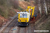 140221-005     The Hitachi Zaxis 135 US hydraulic excavator fitted to HOPS MPV no 99 70 9131 006-7, seen digging stanchion bases at Ollerton on the High Marnham Test Track. The spoil wagon is a JNA 'Falcon' no 29024.