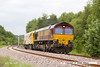 140530-002     DB Schenker class 66/0 no 66067 is captured approaching Boughton Junction on the High Marnham Test Track, powering train 6X26, the 04.30 Dollands Moor to High Marnham. It is seen hauling Windhoff MPV no 99 70 9131 011-7, another new vehicle of the HOPS (High Output Plant System) OHLE electrification train which is undergoing commissioning trials on the test track.