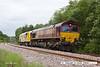 140530-005     DB Schenker class 66/0 no 66067 is captured approaching Boughton Junction on the High Marnham Test Track, powering train 6X26, the 04.30 Dollands Moor to High Marnham. It is seen hauling Windhoff MPV no 99 70 9131 011-7, another new vehicle of the HOPS (High Output Plant System) OHLE electrification train which is undergoing commissioning trials on the test track.