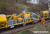 140227-012    Hosing down the concrete mixing unit on the HOPS electrification train. It takes around a hour to clean it all down after use. Seen at Ollerton on the High Marnham Test Track.