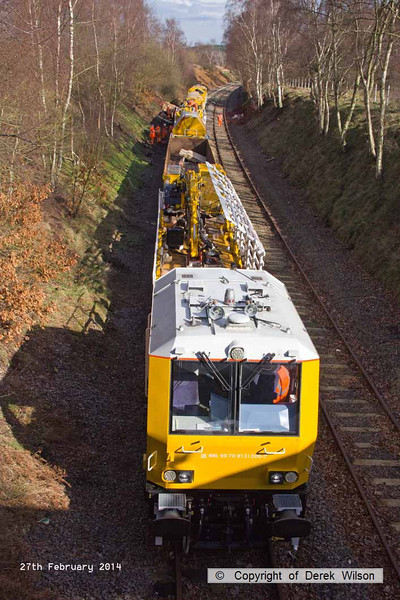 140227-005     The HOPS electrification train, seen near School Lane Ollerton, on the High Marnham Test Track. Nearest is the excavation consist, followed by the concrete batching consist which is busy concreting one of the stanchion bases.
