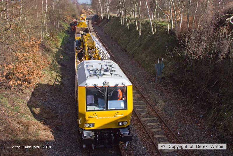 140227-003     The HOPS electrification train, seen near School Lane Ollerton, on the High Marnham Test Track. Nearest is the excavation consist, followed by the concrete batching consist which is busy concreting one of the stanchion bases.