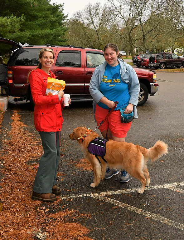 . Nova , a Service Dog in training with Sam Squailia and Kimberly Kovac. Sentinel & Enterprise / Jim Fay