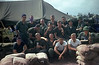 "1967 HQ and Service Battery Survey Section. Duc Pho Vietnam<br /> <br /> Front Row: L to R. Jack Dugger, Tom Hammonds, Dwight Houchens, Bill Sigman, Steven Mundt, Paul Tommell<br /> <br /> Second Row: L to R. Larry Miguez, Dave Dawson, ""Slip"" Homyak, Bob ""Ernie"" Earnhardt, Jim Hinkle with helmet on<br /> <br /> Back Row: L to R. Jim Vauthier, Howard"" Spanky"" Kyriss, Dennis Ebinger, Gary Donatelli, Stanley Tamuleweicz,"
