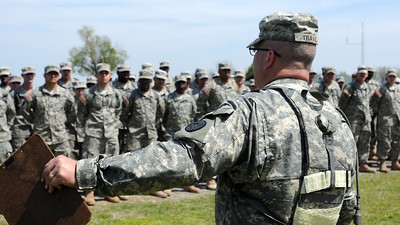 In this image, released by JTF-71, 1st Sgt. Timothy Travis holds formation for HHC, JTF-71 (MEB) to prepare the troops for JRSOI before starting the Vigilant Guard exercise April 14 at Camp Gruber, Oklahoma.