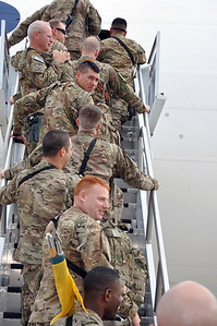 In this photo, released by the 36th Infantry Division, the Soldiers of the 136th Maneuver Enhancement Brigade depart for their deployment to Afghanistan from the Fort Hood mobilization flight line September 15, 2012. Photo by Ms. Gloria Harris of the Fort Hood Mobilization Brigade.