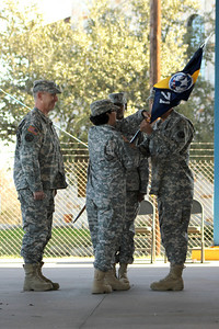 In this image released by the Texas Army National Guard members of Joint Task Force 71 Headquarters Company conducted a change of command ceremony at the Bee Cave Armory in Austin, Texas, Saturday, January 7, 2012. Brigade commander, Col. Lee Schnell presided over the exchange between Cpt. Jo Ann Wollenberg, outgoing commander, and Cpt. Ingrid Welsh, incoming commander, as they participated in the traditional military hand-off of the company 'colors', a flag with the unit symbol emblazoned upon it. Family and friends of both commanders were on hand to enjoy the program and visit with the Soldiers off HHC. (Photo/100th Mobile Public Affairs Detachment, Army National Guard Staff Sgt. Caroline Bonham)