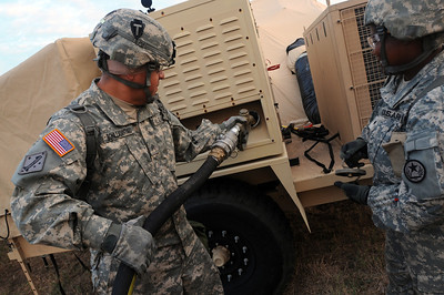 In this image released by the Texas Military Forces, Soldiers with Joint Task Force 71 Headquarters Headquarters Company refuel generators and vehicles at Texas A&M University Riverside Campus during JTF 71's Homeland Response Force external evaluation Wednesday, October 12, 2011. The unit maintained the brigade's life support area during its evaluation at the Texas Engineering and Extension Service Disaster City. During the evaluation, the brigade demonstrated its search and extraction, chemical decontamination and medical triage capabilities in a scenario involving several hundred casualties. (Photo/100th Mobile Public Affairs Detachment, Army National Guard SSG Melissa Bright)