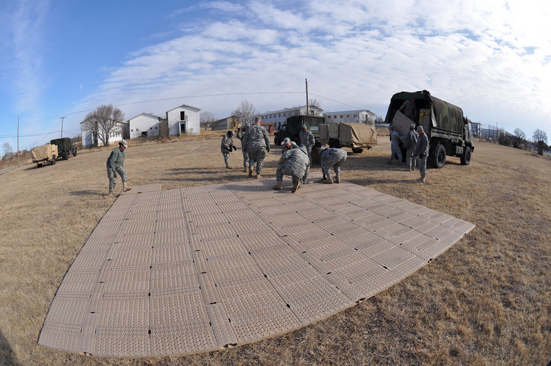 In this image released by the Texas Military Forces, Soldiers from Headquarters Company, Joint Task Force 71 set up a mobile field operations center at Fort Wolters, Texas, Sunday, Jan. 23, 2011. JTF 71, based in Austin, established the center in the Dallas/Fort Worth area as part of a mission to provide support to Super Bowl 45. Throughout the year, the JTF trains to improve its mobility and speed at setting up the necessary facilities in order to better support civilian authorities.  (Photo/Joint Task Force 71, Army National Guard Maj. Adam Collett)