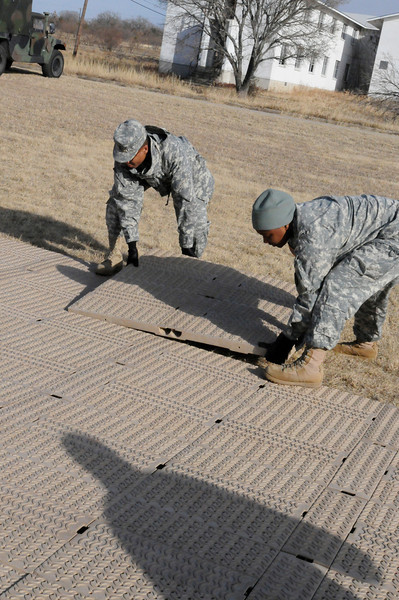 In this image released by the Texas Military Forces, Soldiers from Headquarters Company, Joint Task Force 71 set up a mobile field operations center at Fort Wolters, Texas, Sunday, Jan. 23, 2011. JTF 71, based in Austin, established the center in the Dallas/Fort Worth area as part of a mission to provide support to Super Bowl 45. Throughout the year, the JTF trains to improve its mobility and speed at setting up the necessary facilities in order to better support civilian authorities.  (Photo/Joint Task Force 71, Army National Guard Sgt. Melissa Shaw)