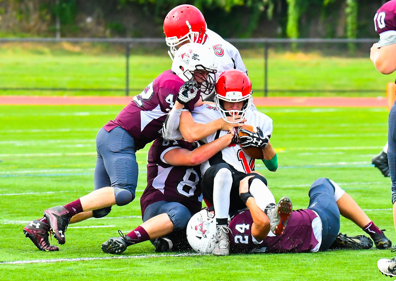 Ayer Shirley's Mick Mitrano, James Driscoll and James Robinson crunch South's Jose Albino. Nashoba Valley Voice/Ed Niser