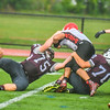 Ayer Shirley's Leo Farrell and Thomas Dentino converge for a tackle. Nashoba Valley Voice/Ed Niser