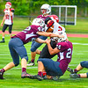 South quarterback Keith Berthiaume is sandwiched by Ayer Shirley's James Robinson and Mick Mitrano. Nashoba Valley Voice/Ed Niser