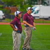 Phil Marchegiani (far right) and the Panthers bench look on during Saturday's win over Worcester South