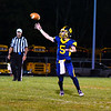 Littleton quarterback Griffin Shoemaker fires a pass. Nashoba Valley Voice/Ed Niser