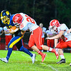 North Middlesex's Dan DiPano records a sack in the second half of Friday night's loss. Nashoba Valley Voice/Ed Niser