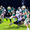 Ayer Shirley's Nick Taylor wraps up Clinton back Dylan Neeley. Nashoba Valley Voice/Ed Niser